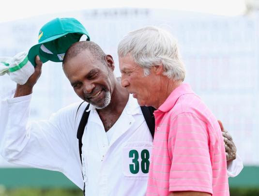AUGUSTA, GA - APRIL 09: Ben Crenshaw of the United States walks off the 18th green with his caddie Justin Jackson during the first round of the 2015 Masters Tournament at Augusta National Golf Club on April 9, 2015 in Augusta, Georgia. (Photo by Jamie Squire/Getty Images)